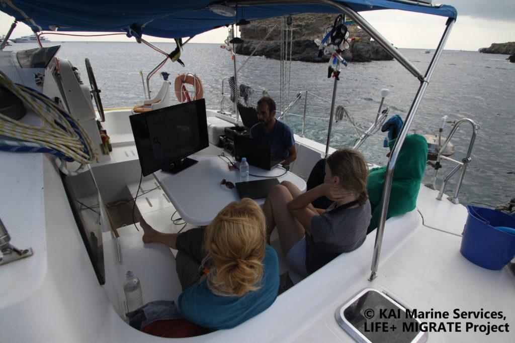 Officers on a boat during surveys